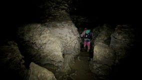 Men Walks in the Cave. Speleolog in the Cave stock video