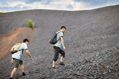 Men walks on stones slope Royalty Free Stock Photography