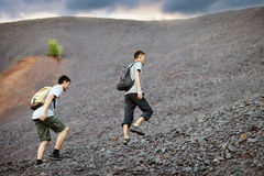 Men walks on stones slope Stock Image