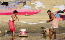 Men washing clothes on the ghats of Varanasi