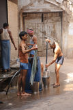 Men washing clothes. Old Delhi, India. Royalty Free Stock Photography
