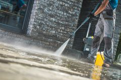 Men Washing Driveway royalty free stock photography