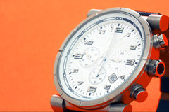 Men Watch. Isolated on orange background Royalty Free Stock Photography