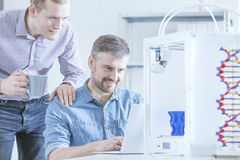 Men watching 3D print. Fascinated men watching 3D print with high interest Stock Photography