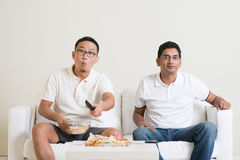 Men watching live sport game on tv together Stock Photo