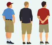 Men Watching Something Viewed from Back. Three white men shown from behind in the 3/4 view and wearing shorts Stock Photos