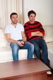Men watching tv Stock Image