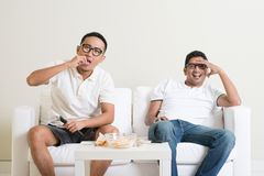 Men watching tv together Royalty Free Stock Images