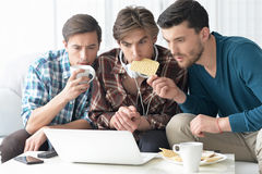 Men watching video on laptop Stock Images