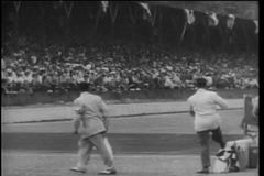 Men waving white flag at the Indy 500 stock video footage