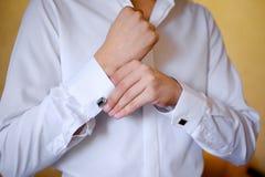 Men wear a cufflinks. Men wear a shirt and cufflinks Stock Photos