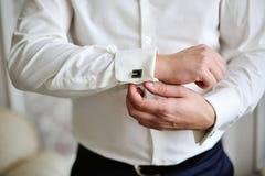 Men wear a cufflinks. Men wear a shirt and cufflinks Royalty Free Stock Photography