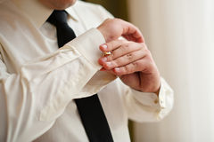 Men wear cufflinks on a shirt sleeve Stock Image