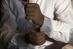 Men wear cufflinks on a shirt sleeve Royalty Free Stock Image