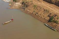 Men wear red fishing boat. Stock Photo