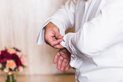 Men wear a shirt and cufflinks close-up Stock Photos