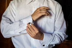 Men wear a shirt and cufflinks. Correct clothes, dressing Royalty Free Stock Photography