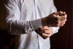 Men wear a shirt and cufflinks. Correct clothes, dressing Royalty Free Stock Images