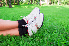 Men wear sports running shoe on the grass green. Men wear sports running shoe on the grass green in relax time Royalty Free Stock Photos