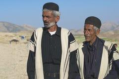Men wear traditional dresses circa Isfahan, Iran. Royalty Free Stock Photography