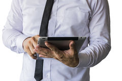 Men wear white shirt. Black tie, trustworthy businessman, in handheld tablet running, with finger on the screen Stock Photos