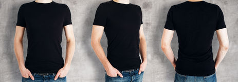 Men wearing empty black shirt. Three man wearing casual black shirt on concrete background. Front, back and side views. Retail concept. Mock up Stock Photos
