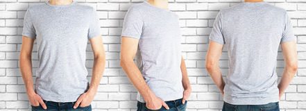 Men wearing empty grey shirt. Three man wearing casual grey shirt on brick background. Front, back and side views. Retail concept. Mock up Royalty Free Stock Images