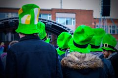 Men Wearing Green Hats Attend Live Concert at Belfast in St Patrick`s Day. Belfast St Patrick`s Day Celebration 2018. Group of Men Wearing Green hats Attend Live Royalty Free Stock Photography