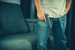 Men wearing t-shirts, jeans Standing holding a gun in the house.  stock image