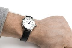 A men wearing a watch with black leather strap over a white back Stock Photos