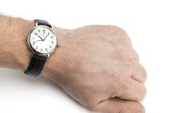 A men wearing a watch with black leather strap over a white back Stock Images