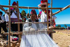 Men weaving in the peruvian Andes at Puno Peru. Puno, Peru - July 25, 2013: men weaving in the peruvian Andes at Taquile Island on Puno Peru at july 25th, 2013 Royalty Free Stock Image