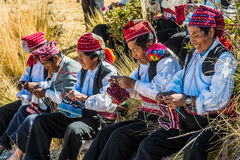 Men weaving in the peruvian Andes at Puno Peru Royalty Free Stock Photos