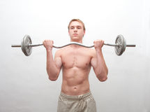 Men with weight bar Royalty Free Stock Photo
