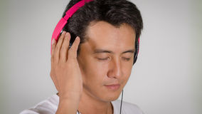 Men were listening headphone Royalty Free Stock Image