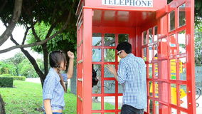 Men were talking telephone in a public phone. HD Royalty Free Stock Images