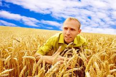 Men in wheat field Stock Photography