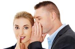 Men whispering secret to his friend. Men whispering secret to his surprised friend Royalty Free Stock Image