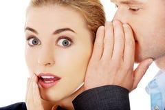 Men whispering secret to his friend. Men whispering secret to his surprised friend Stock Images