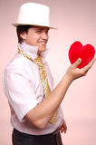 Men in white cap with tie and heart. Stock Photo