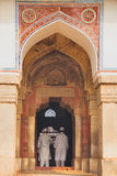 Men in white dresses standing at Isa Khan Niyazi tomb entrance, Stock Images