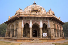 Men in white dresses walking at Isa Khan Niyazi tomb, Humayun's Royalty Free Stock Photo