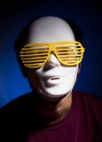 Men in white mask. And yellow glasses Stock Photo