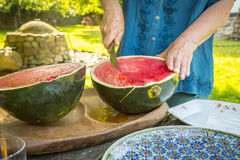 Men who is cutting a water melon Royalty Free Stock Photos