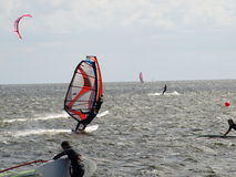 Men on windsurfing. On the sea royalty free stock image