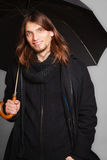 Men winter fashion. Man in black coat with umbrella Royalty Free Stock Image