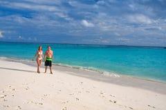 Men and woman at the beach and ocean, Maldives stock photos