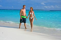 Men and woman at the beach and  ocean, Maldives Stock Images
