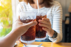 Men and Woman hand giving glass of cola.Glass of cola. Soft drinks with ice, sweethart or buddy Stock Photos