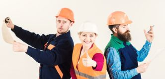 Men and woman in helmets busy with different tasks white. Men and women in helmets busy with different tasks white background. Team work concept. Inspector stock photos